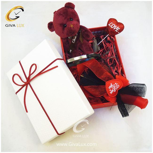 پک کادویی شامل جعبه خرس بنفش گل قرمز روبان دار قلب  دستبند  اسپرت